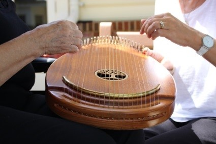 Music therapy with an instrument