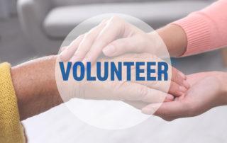 volunteer image woman holding elderly lady's hand